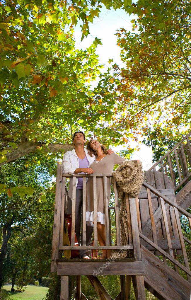 Loving couple stand on wood deck outdoor