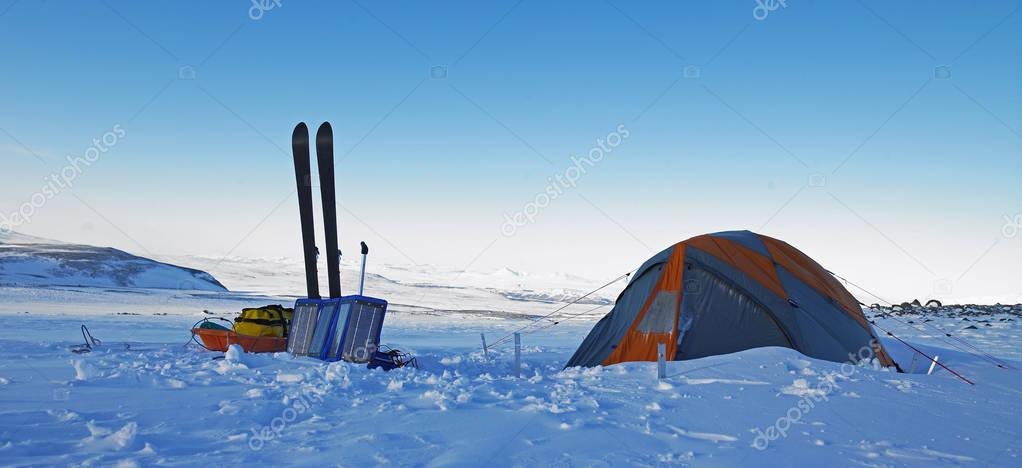 Campsite located in snow covered field