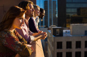 friends on roof top in city