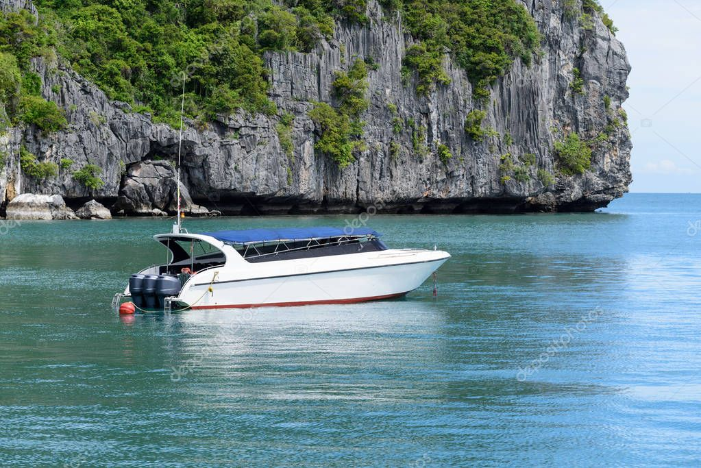 Speed boat floating in beautiful sea landscape of Thailand tropi