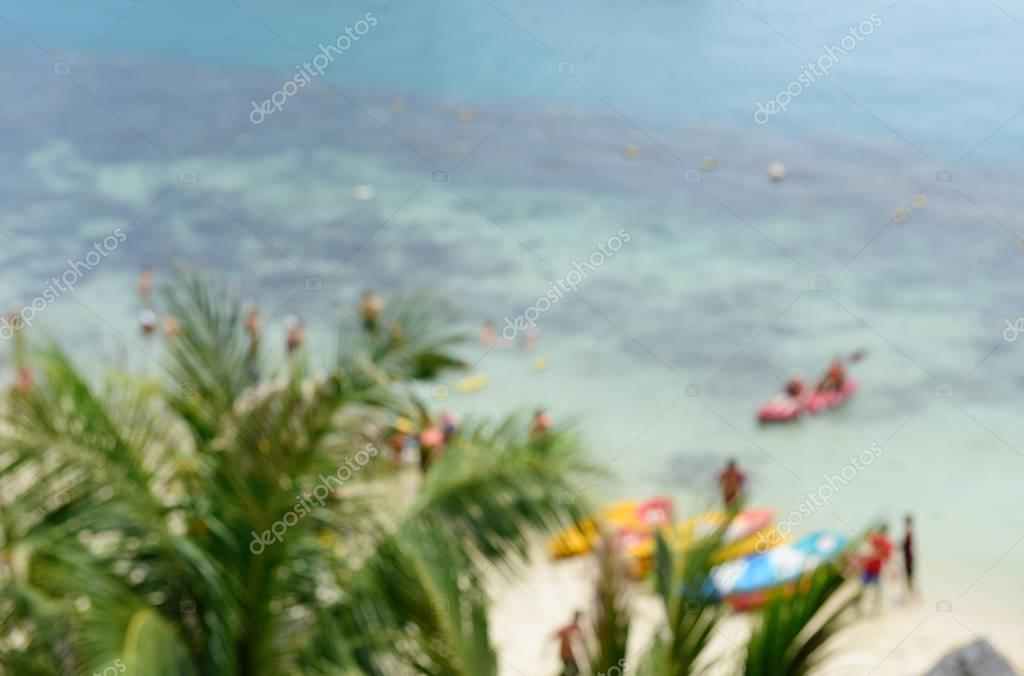 Blurred image of tourist kayaking in the Thai ocean with blue se