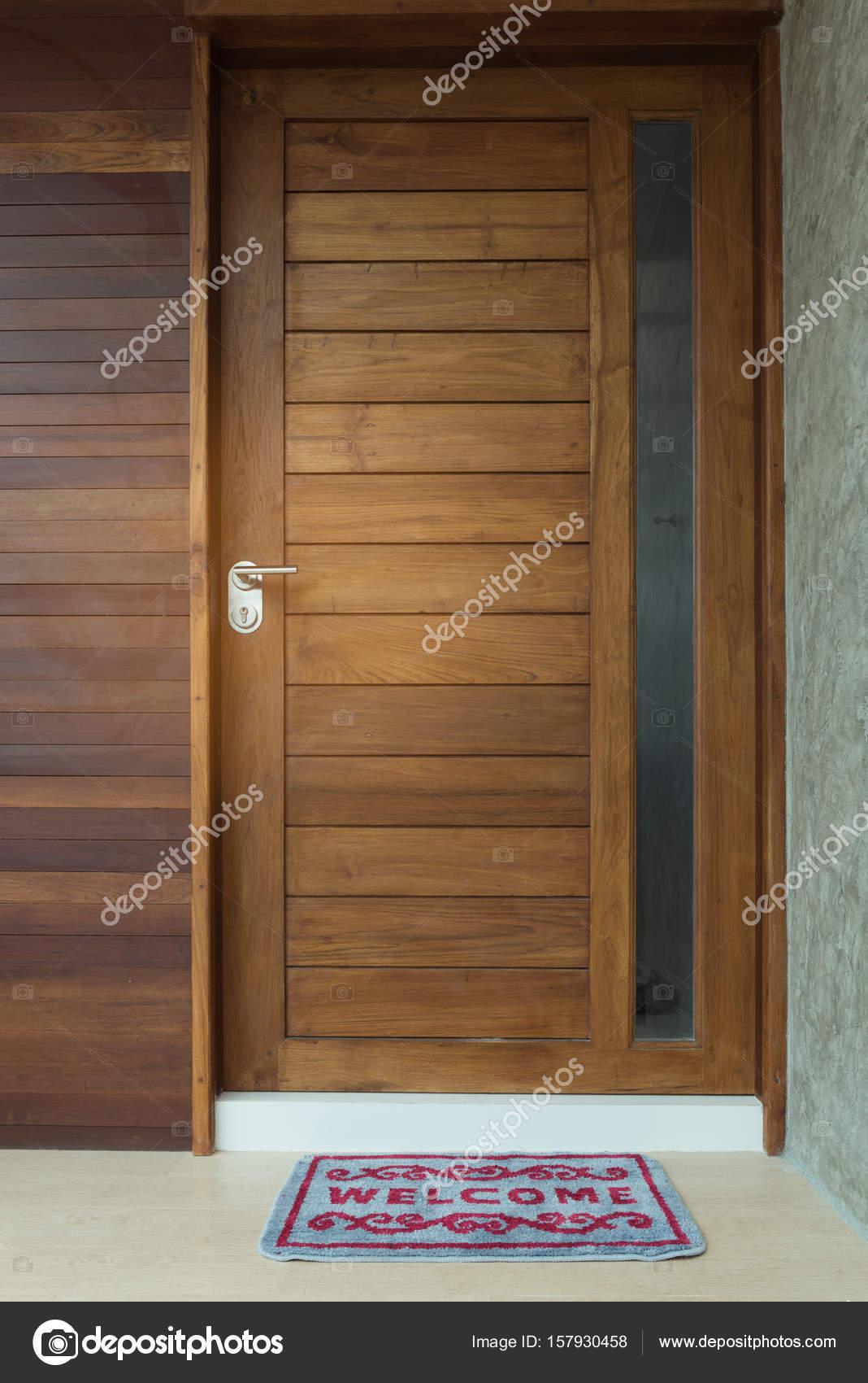 Welcome Door Mat Infront Of Teak Wooden Door Background U2014 Stock Photo