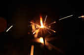 Hořící a jiskřící jiskra Nový rok slavnostní bokeh pozadí