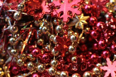Christmas shiny background with a flickering garland, New Year's bright decor details macro photo lights