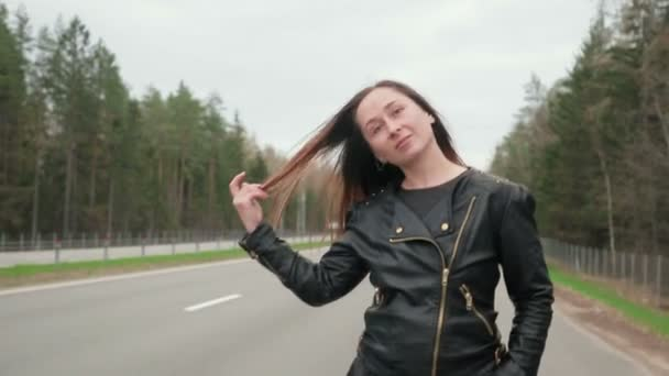 Young, pretty road prostitute goes along the road