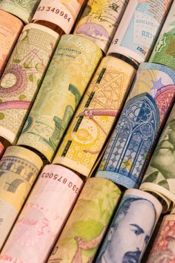 Different banknotes from various countries on rolls