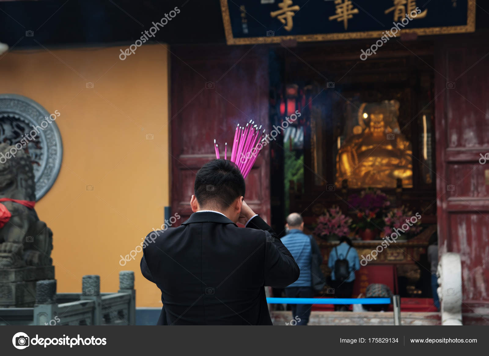 Chinese Man Is Praying At A Buddhist Temple And Burning Incense Sticks Stock Editorial Photo C Eteri 88 175829134