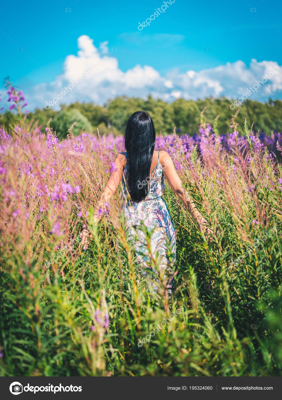 Young Brunette Woman Dress Standing Tall Grass Purple Flowers Field