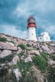 Fotografie Dramatischer Himmel über Welt berühmten Lindesnes Fyr Leuchtturm am südlichen Punkt von Norwegen am Rand der felsigen Küste