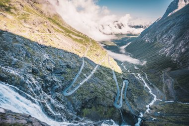 Amazing view over famous world roads.Trollstigen serpentine mountain road in Norway. Big waterfall
