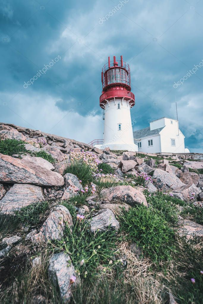 dramatic sky over World famous Lindesnes Fyr Lighthouse on southern point of Norway on edge of rocky sea coast