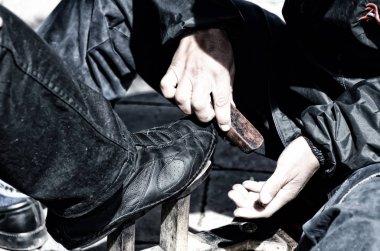 Shoe shiner cleaning shoe