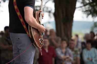outdoor concert, musician playing guitar