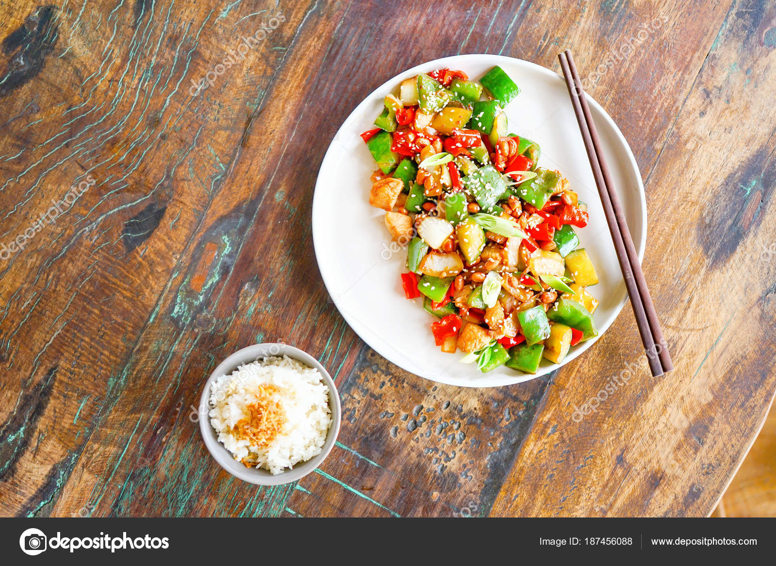 Chicken kong pao white plate light wooden table chinese food stock chicken kong pao on a white plate and on a light wooden table chinese food food sticks in the frame the hand holds the dumpling with chopsticks forumfinder Gallery