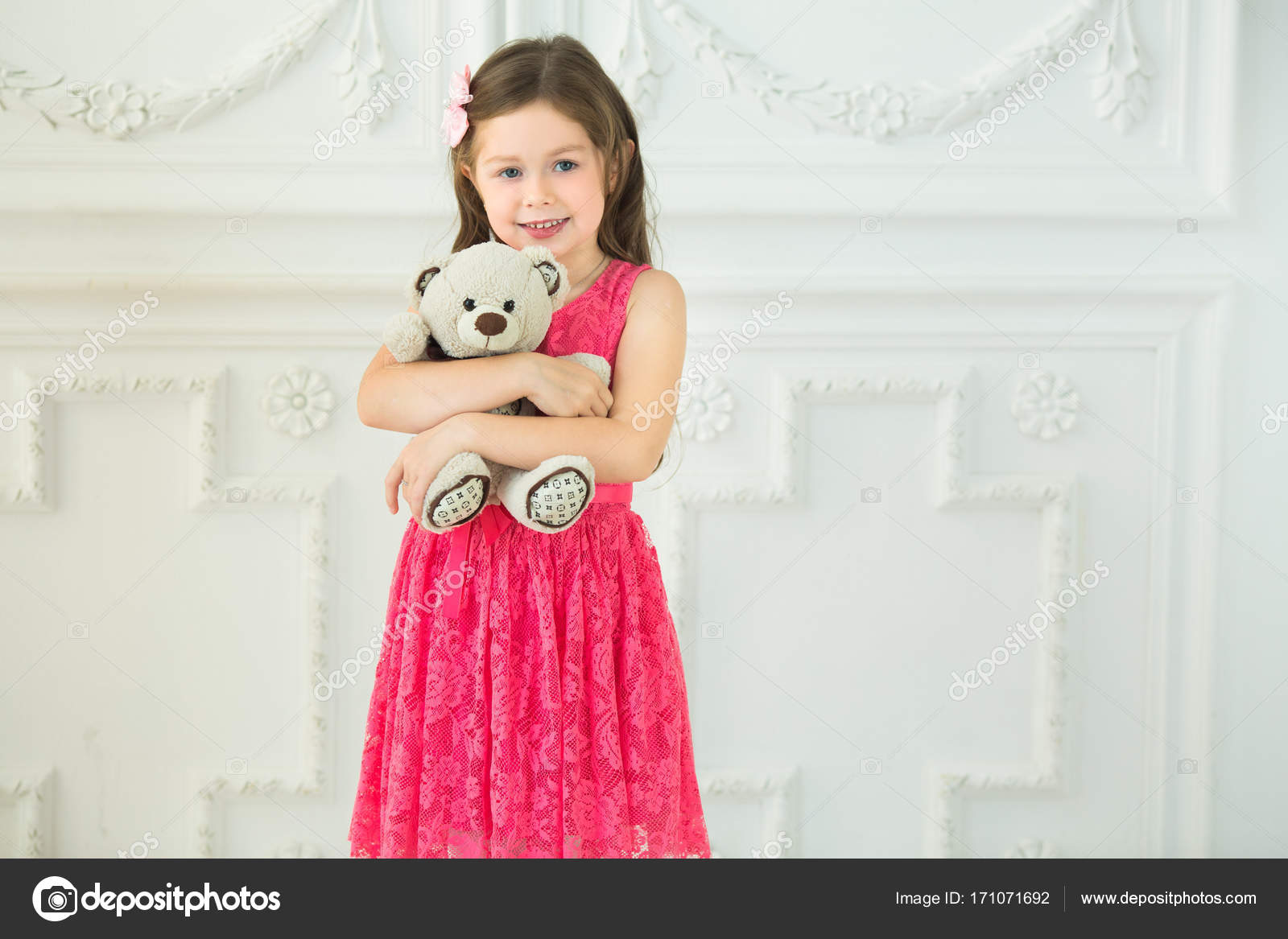 smiling beautiful baby girl in a red dress — stock photo © zoom01