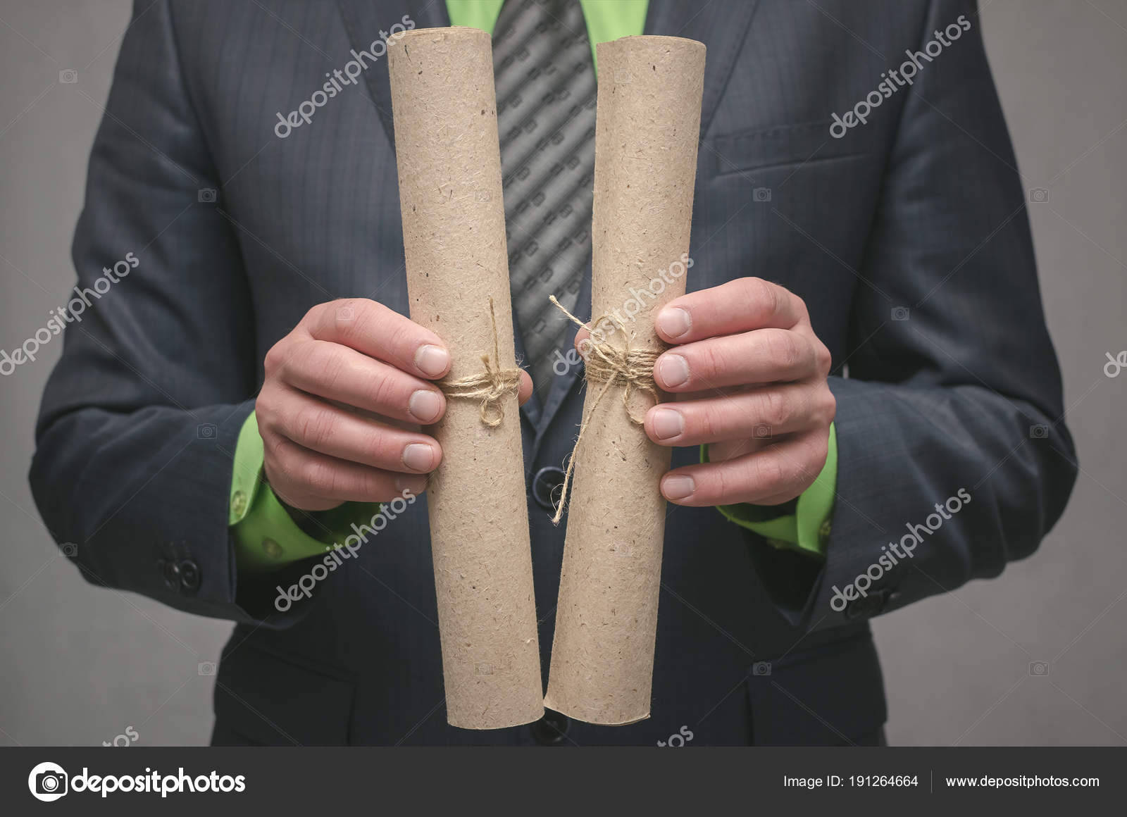 Businessman Holds Hand Rolled Document Scroll Signing Agreement