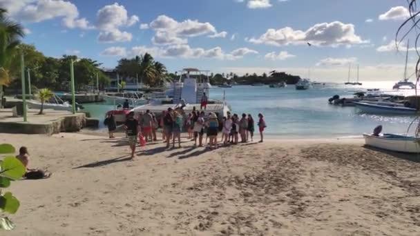 BAYAHIBE, DOMINICAN REPUBLIC 22 JANUARY 2020: Landing tourists on the Bayahibe beach