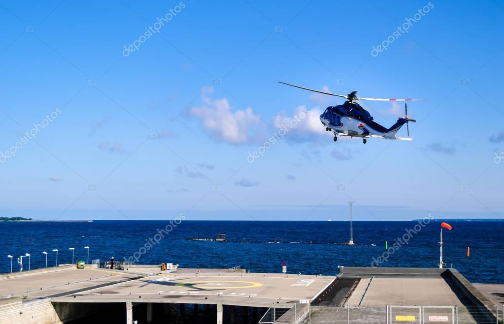Helicopter starting from helipad By Tallinn - Baltic sea