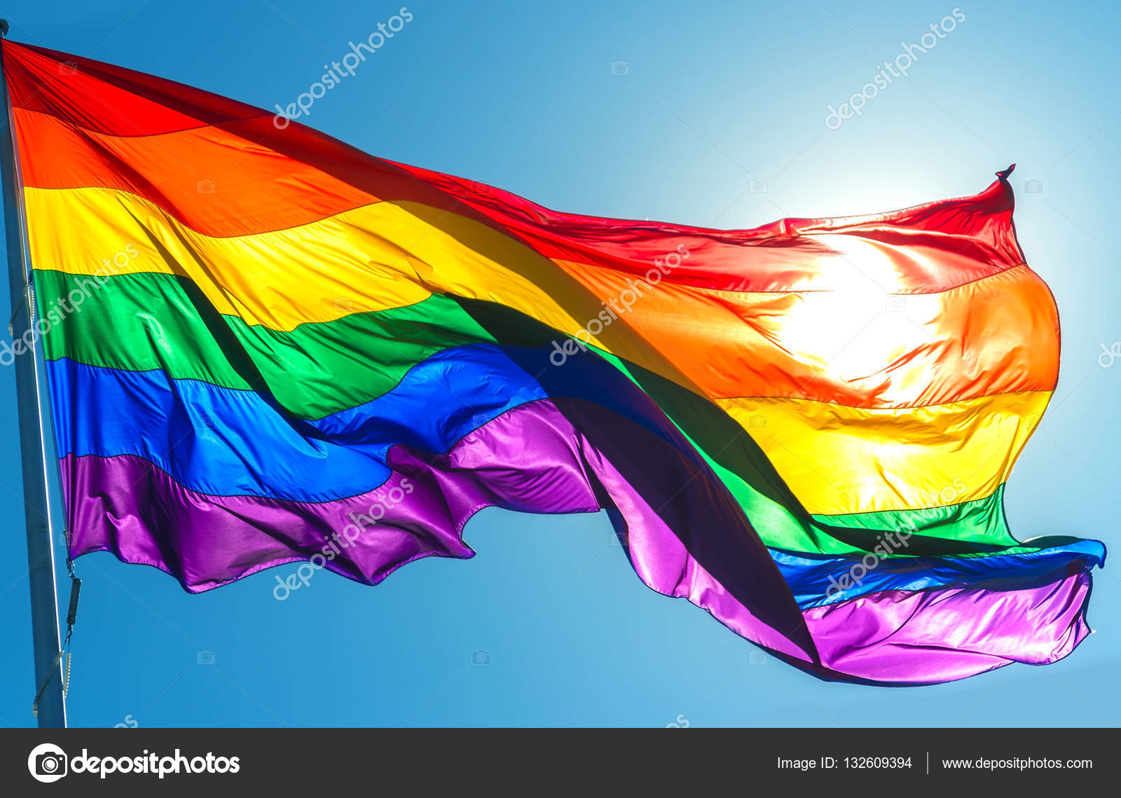 Rainbow flag on the blue sky background symbol of tolerance and rainbow flag on the blue sky background symbol of tolerance and stock photo biocorpaavc Image collections