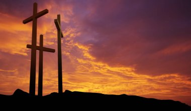 Three crosses on over dramatic sky panoramic view