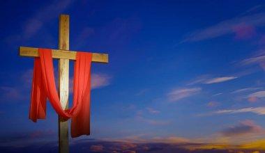 Cross draped in red represents Lenten Season