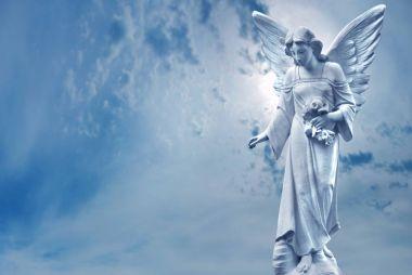 Guardian Angel sculpture over bright sky