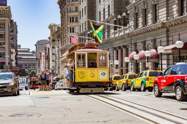 SAN FRANCISCO CA. - JULY16: Passengers ride in a cable car on Ju