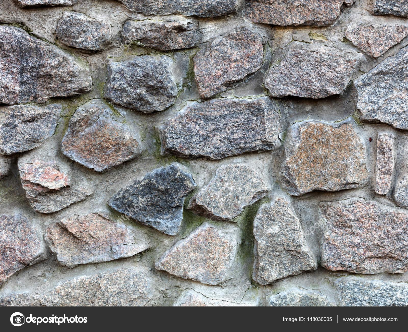 La pared de piedra de una cerca de piedra grande del for Piedra de granito precio