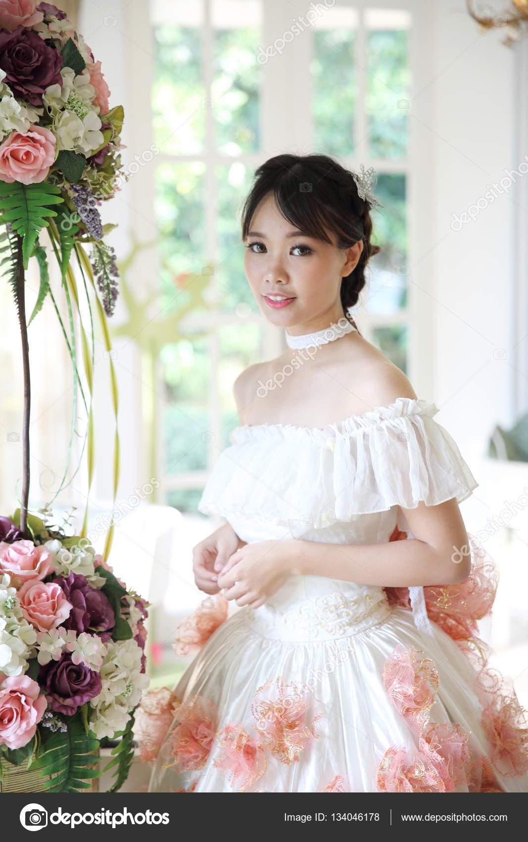 Asian Bride in white dress — Stock Photo © piyato #134046178