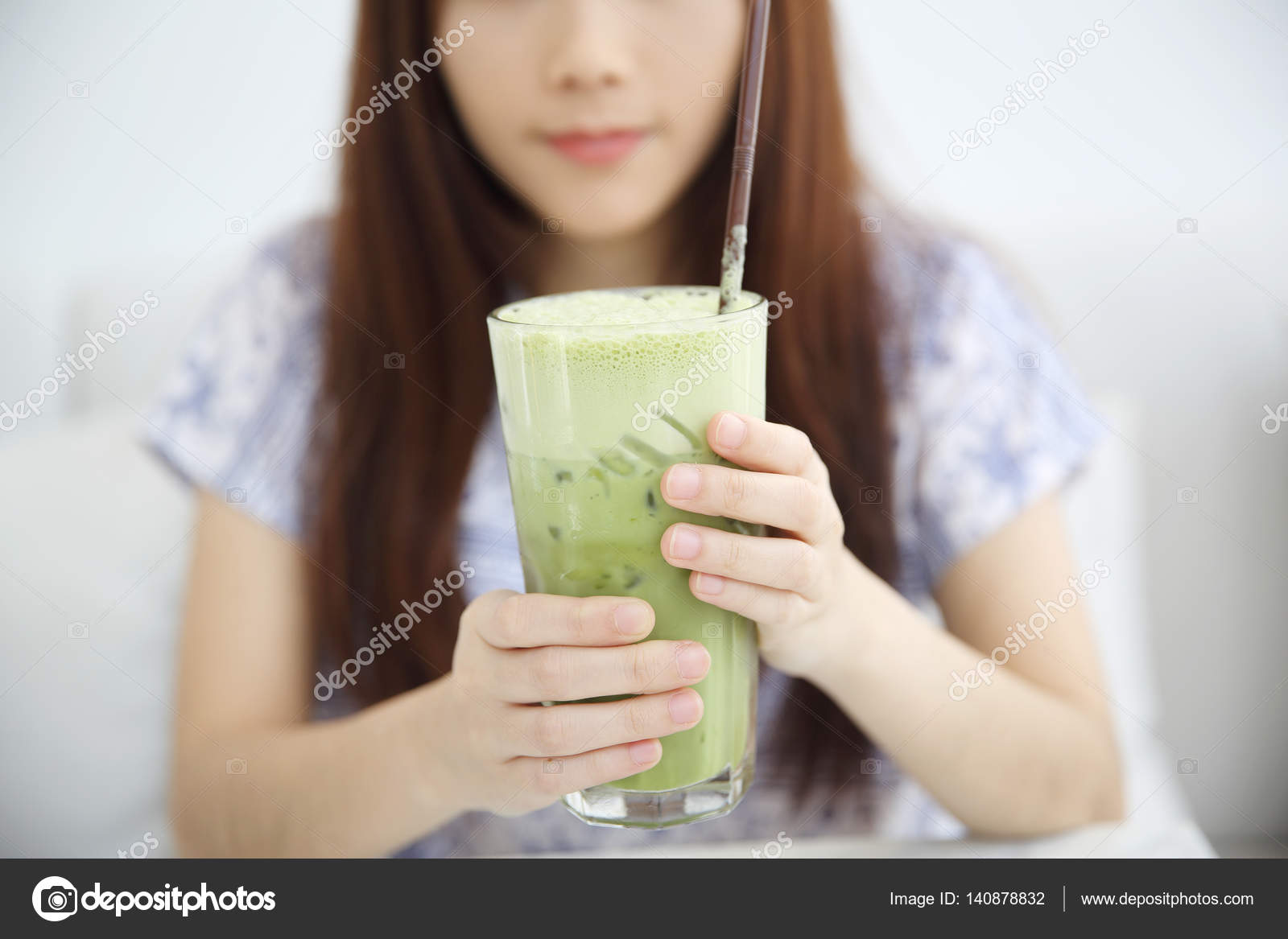 65f24a1d2 Asian young woman drinking Iced green tea latte in white coffees– stock  image