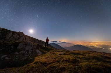 Night on the mountain with stars at full moon