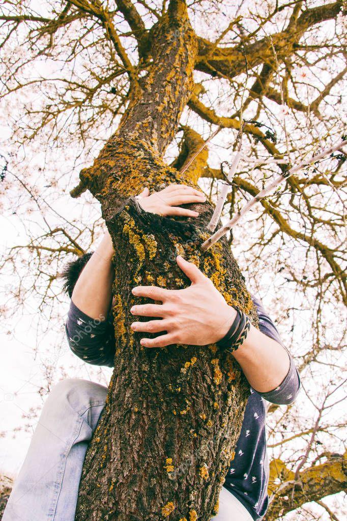 man on tree branch