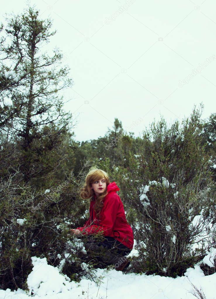 woman in red coat in winter