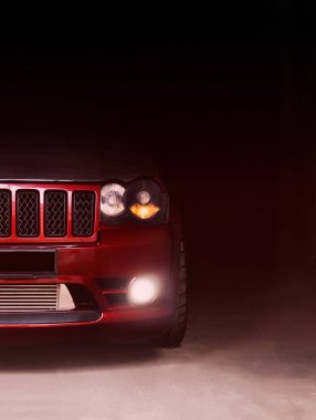 Kharkov, Ukraine. January 3. Part of the Jeep Grand Cherokee SRT8 in the shadows with glowing lights in low light. Editorial photo