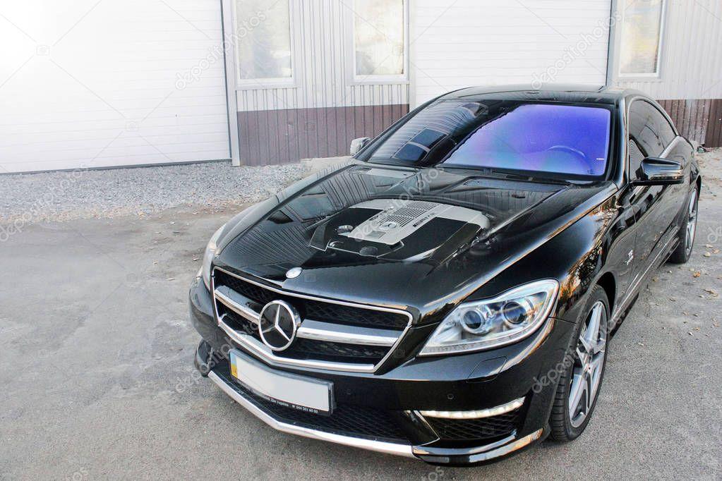 October 7, 2015; Kiev, Ukraine. Mercedes engine. Mercedes-Benz CL 65 AMG V12 Bi-Turbo. Headlights. Luxurious. Tuning. Supercar. Editorial photo.