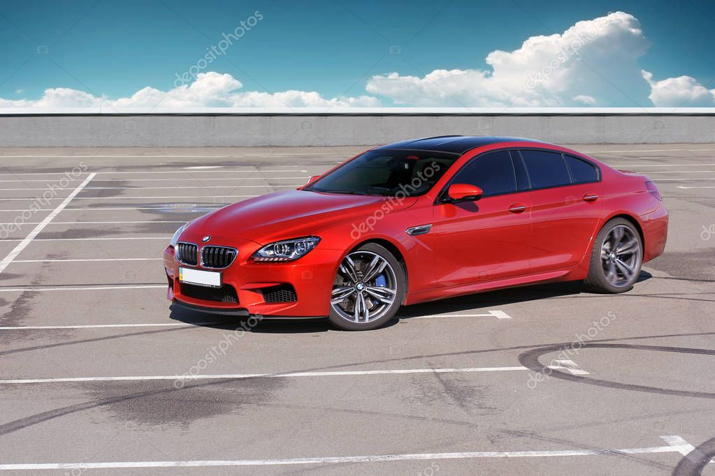 July 5, 2016; Kiev, Ukraine. BMW M6 on a background cloudy sky. Speedway. Speed. Car. Karbon. Race. Luxurious. Tuning. Supercar. Editorial photo.