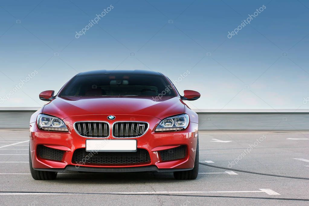 April 7, 2014; Kiev, Ukraine. BMW M6 on a background of clear sky. Luxurious. Tuning. Supercar. Editorial photo.