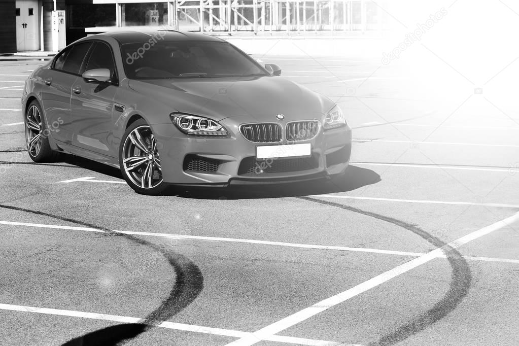 April 10, 2014. Kiev, Ukraine; BMW M6 and tire tracks. Black and white photo. Speedway. Speed. Car. Karbon. Race. Luxurious. Tuning. Supercar. Editorial photo.
