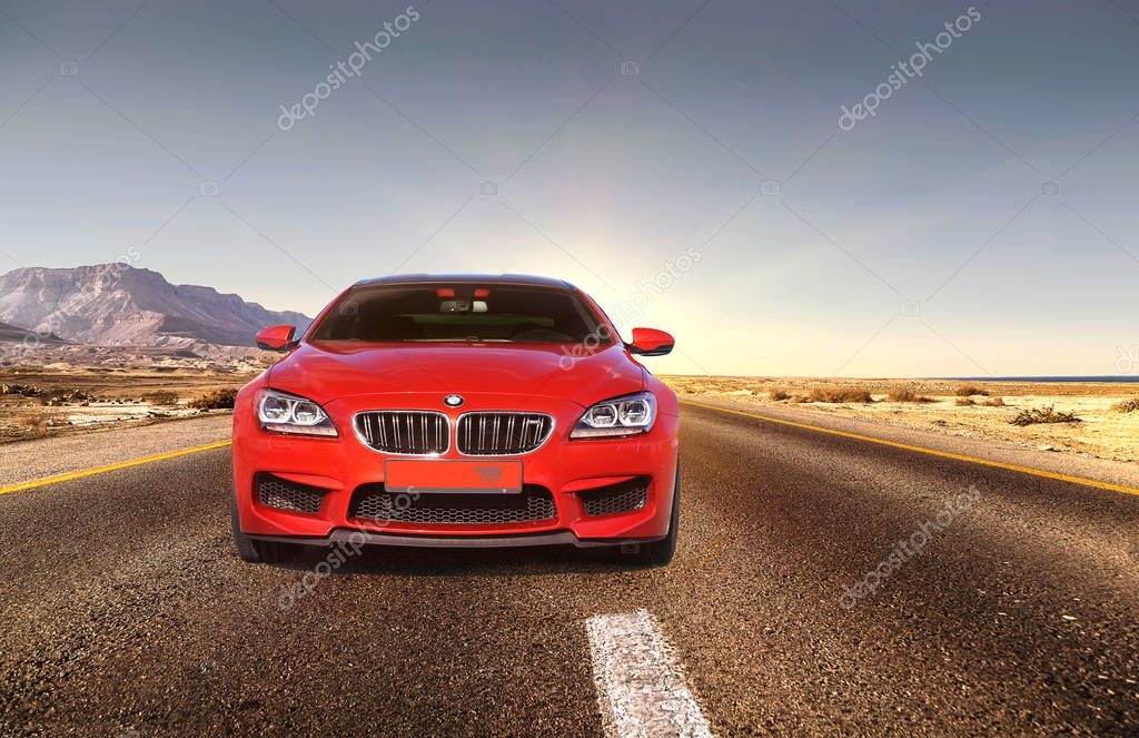 July 5, 2016; Kiev, Ukraine. BMW against the backdrop of the sunset on the road. BMW M6. Speedway. Speed. Car. Karbon. Race. Luxurious. Tuning. Supercar. Editorial photo.