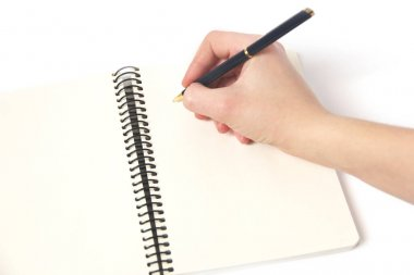 Pen in hand and notebook on a white background