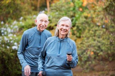 Fit older couple standing in garden