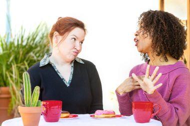 Doubtful woman listening to friend