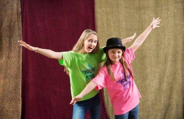two girls posing at camera