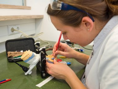 Female dental technician working in a dental lab