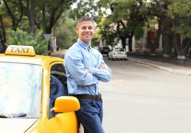 taxi driver near car