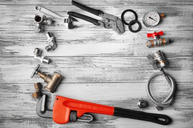 Plumber tools frame on wooden structure background