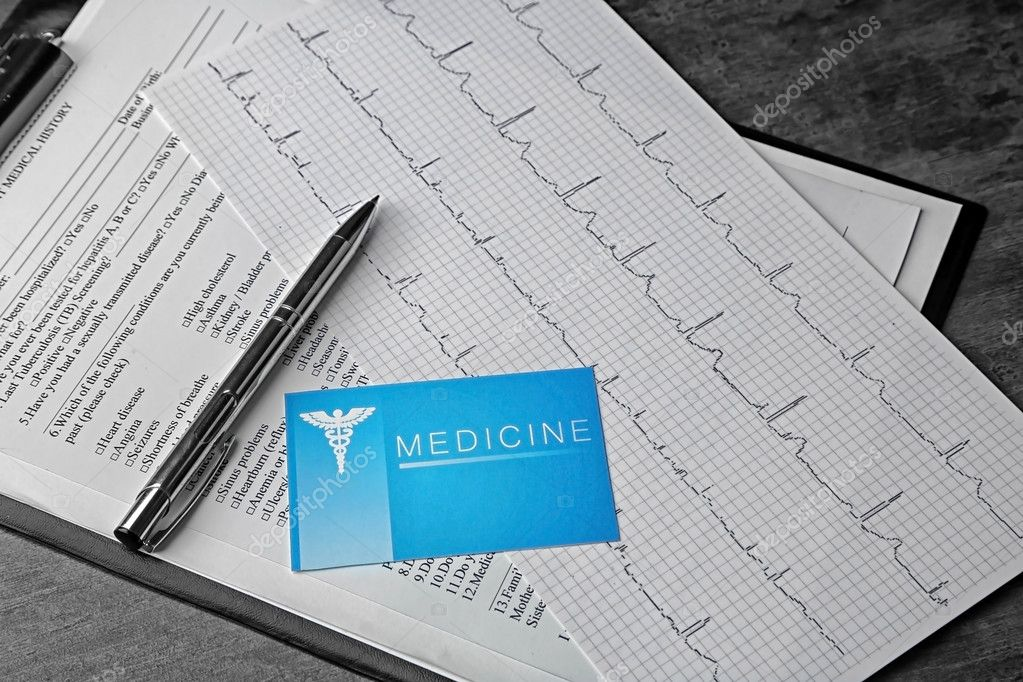 Medical concept  Medical history, business card an ECG chart