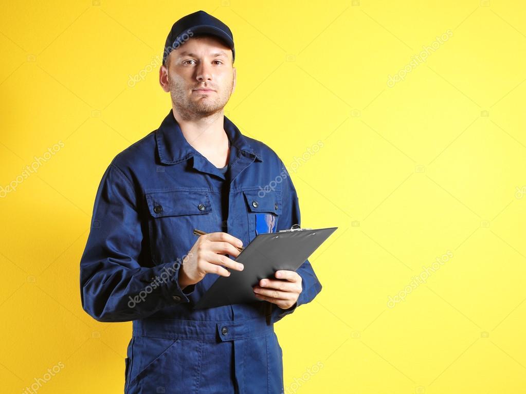 Young mechanic in uniform
