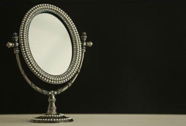 woman antique mirror