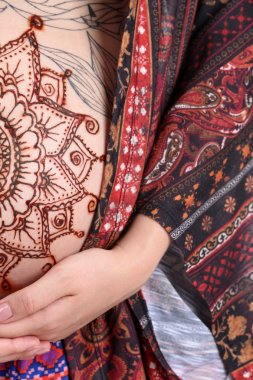 Henna tattoo on pregnant belly
